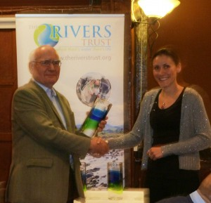 Bella receives the award from Ivor Lewelyn, Director of the Atlantic Salmon Trust
