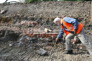 Investigating the uncovered brick walls of the gunpowder mill.