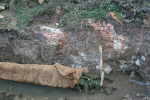The remains of the Corning Mill which have laid forgotten behind the abutment walls of the upstream weir.