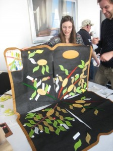 Chloe and Glen from Kent and Surrey Wildlife Trusts caefullly fold up a Ketso mat without losing its leaves